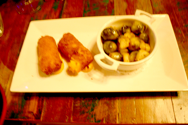 Roasted baby Brussels sprouts with pear; potato croquetas