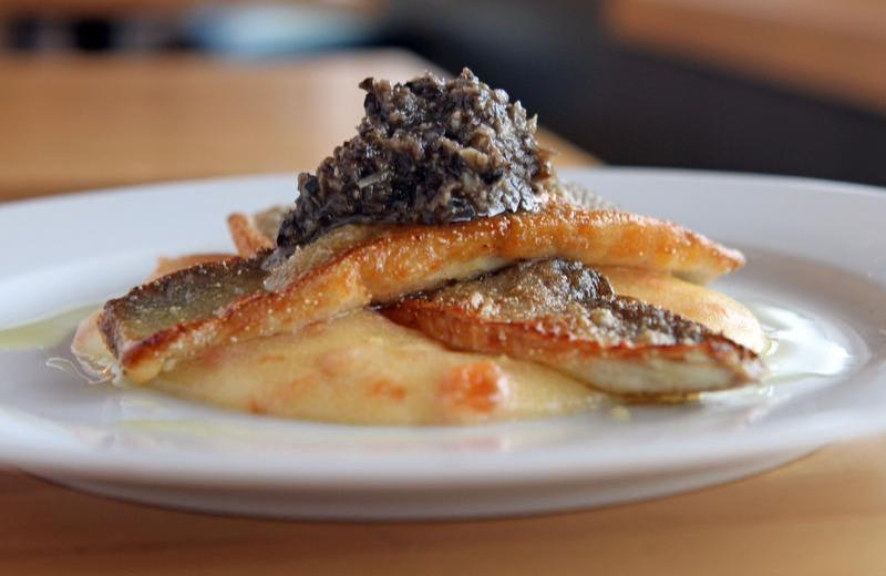 Branzino over a creamy tomato polenta, topped with a kalamata olive tapenade, prepared by Brian Galvin, owner and chef at Ocean House in Croton