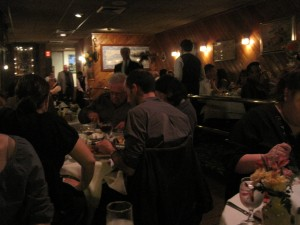 The cozy and bustling dining room of Caravela on a Saturday night.