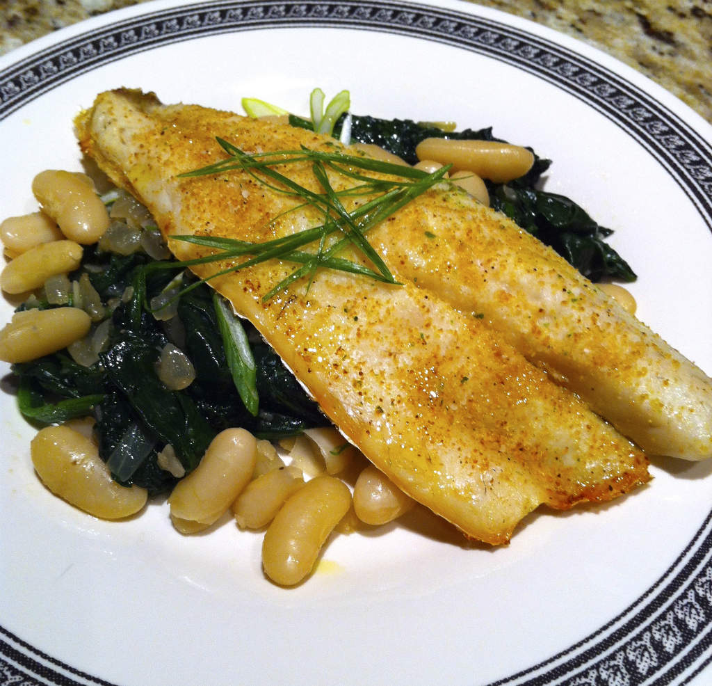 Branzino Filet over Sautéed Spinach and Beans