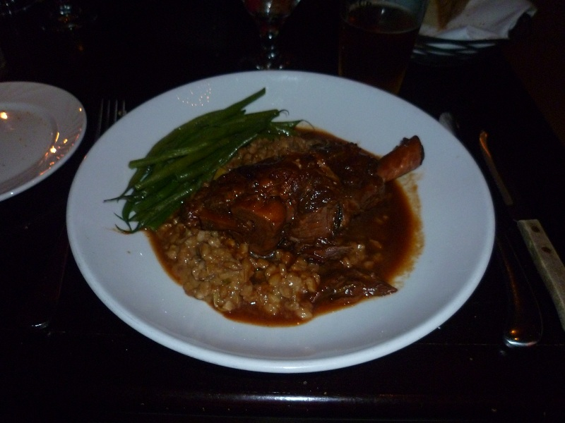 Braised Lamb Shank over Barley Risotto with Granny Smith Apples, Green Beans & Red Wine Sauce