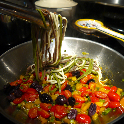 Add tomatoes, olives and pasta.