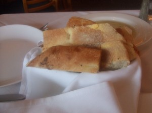 Turkois Bread Basket, olive oil with herbs in backgr.