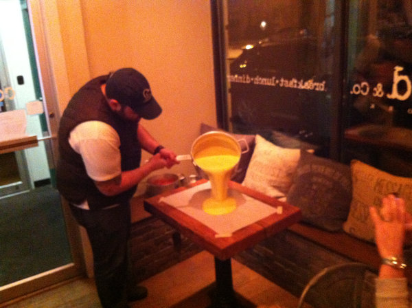 Christian Petroni pouring polenta for the polenta table.
