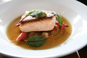 Pan Roasted Salmon with vidalia onion broth, caramelized cippolini onions, breakfast radishes and green apple with a horseradish gremolata, part of the Hudson Valley Restaurant Week menu at The Hudson House of Nyack,
