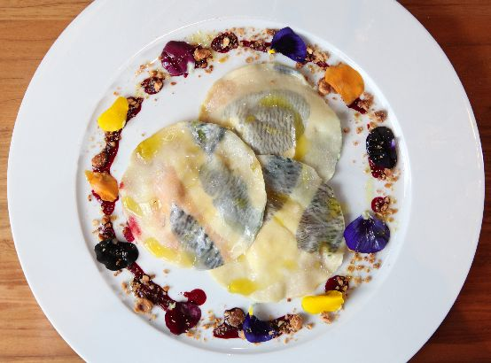 The Wild Flower Ravioli, with orange poppy seed ricotta stuffing, beet glaze and candied hazelnuts, at Modern Barn, Armonk. ( Tania Savayan / The Journal News )